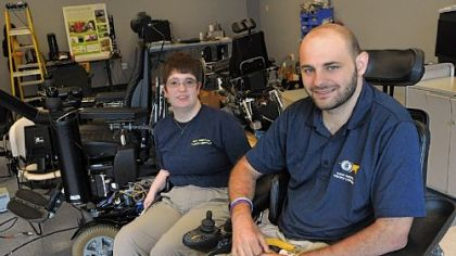 Elaine Houston and Jonathan Duvall in the lab with Ms. Houston's wheelchair project at the University of Pittsburgh. Mr. Duvall is working on his master's degree in rehabilitation engineer-ing and wants to pursue a doctorate. Ms. Houston is working on a doctorate in the field.
