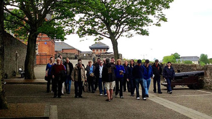 Tourists walk along the circumference of Derry's walled city, the only remaining completely intact walled city in Ireland. Built in the early 1600s, it was blocked only two decades ago by barbed wire and British soldiers.