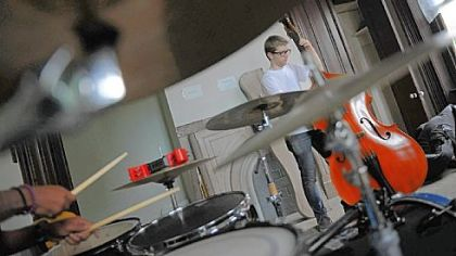 Sam Harris, 18, of Point Breeze plays bass during a jazz band rehearsal at the Center of Life in Hazelwood this month.