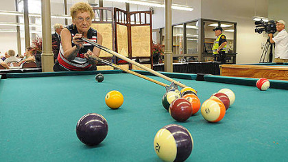 Phyllis Haduch of Mount Washington lines up her shot while playing pool at the historic South Side Market House today.