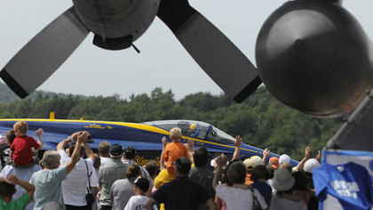 The crowd waves as one of the pilots of the U.S. Navy's Blue Angels taxis for takeoff Sunday at the Westmoreland County Air Show at Arnold Palmer Regional Airport near Latrobe.