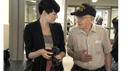 Al Kopycinski, 88, of the Southside chats with Amanda Swadlo, a graphic designer with Zoltun Design Studio, as she pauses while taking photos of the remodeled interior of the South Side Market House. Zoltun is across the street from the historic building.