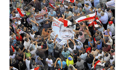 Egyptians celebrate the victory of Mohammed Morsi in the country&#039;s presidential election on Sunday in Cairo&#039;s Tahrir Square.