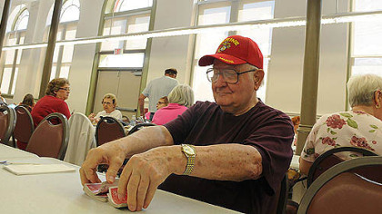David Stipe, 81, of the South Side makes himself at home with a deck of cards today at the South Side Market House.