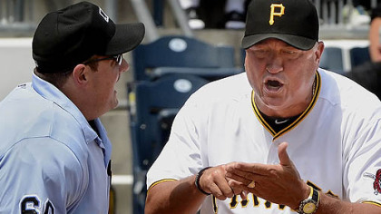 Pirates manager Clint Hurdle argues called third strike on Casey McGehee with home plate umpire Marty Foster against the Tigers Sunday afternoon at PNC Park.