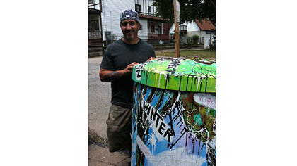 Chris Galiyas is one of 10 artists chosen to paint a rain barrel for installation in public places throughout the city.