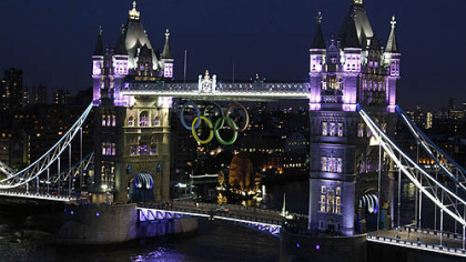 The Olympic rings are seen atop the iconic Tower Bridge in London coinciding with one month to go until the start of London 2012 Games, Wednesday evening, June 27, 2012. The giant rings, which are fully retractable to allow for tall ships to pass through the bridge, will remain in position for the duration of the Games.
