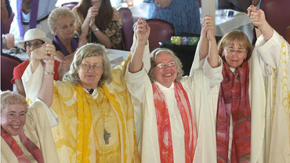 Women ordained as priests and deacons celebrated during a ceremony aboard a riverboat on the Monongahela River in 2006. Among them was Joan Clark Houk, center, shown with Gisela Forster, left, and Eileen McCafferty DiFranco.