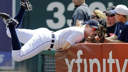 Tigers right fielder and Mt. Lebanon High School graduate Don Kelly tumbles into the stands last week in Detroit. Kelly was injured on a similar play the next day, forcing him to sit out the weekend's series against the Pirates at PNC Park.