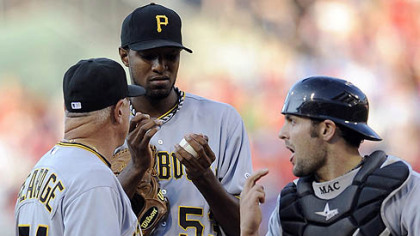 Pirates pitcher James McDonald talks to Ray Searage and catcher Michael McKenry after the Phillies&#039; Carlos Ruiz hit a home run in the first inning.