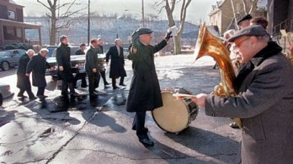 One of South Fayette's first band directors, Dominic Scacchitti, plays baritone at right at the 1997 funeral of a former band director. Band alumni created a scholarship in his name.