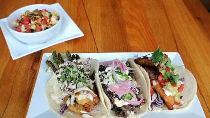 Asparagus tempura taco, skirt steak taco and the Santa Cruz-style fish taco with jicama salad prepared by executive chef Adam Manculich at Yo Rita on the South Side.