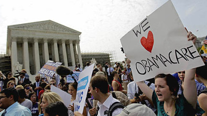 Supporters of President Barack Obama?s health care law celebrate Thursday outside the Supreme Court in Washington.