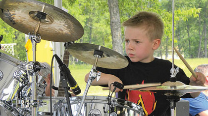 Five-year-old drummer Avery Molek keeps the beat.