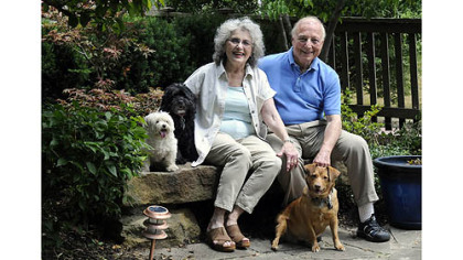 Jerry and Monica Segal with their dogs, Isabella (white), Sabrina (black) and Baby girlen of their Regent Square home.