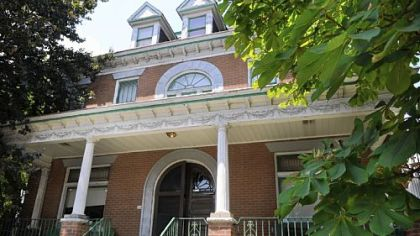 Many of the period details remain in this Victorian house in Knoxville, originally a single-family home buit in the late 1800s. It is now divided into five apartments and is on the market for $80,900.