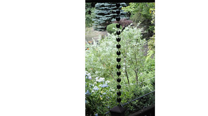 A Japanese rain chain hangs from the deck in Jerry and Monica Segal's garden.