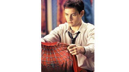 "Tobey Maguire makes his debut as Peter Parker in ""Spider-Man"" (2002)."
