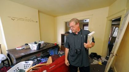Craig Edwards does a walk through at this hoarder house on east 9th Ave in Munhall.