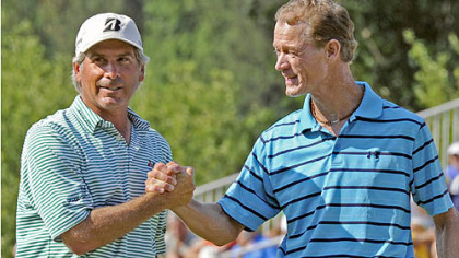 Joe Daley is congratulated by Fred Couples after sinking a birdie putt on the 18th green to go 14 under and win the Constellation Senior Players Championship at Fox Chapel Golf Club Sunday.