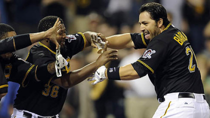 Pirates catcher Rod Barajas is congratulated at home plate after hitting a two-run walk off home May 9 at PNC Park.