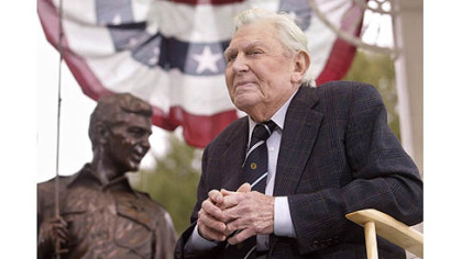 This Oct. 28, 2003 file photo shows actor Andy Griffith sitting in front of a bronze statue of Andy and Opie from the &quot;Andy Griffith Show,&quot; after the unveiling ceremony in Raleigh, N.C.