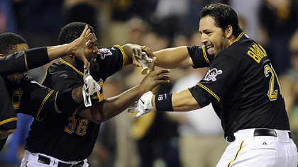 Pirates catcher Rod Barajas flashes the team's new favorite victory sign after he hit a two-run walk off home run May 9 at PNC Park.