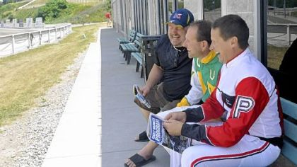 Dave Palone, right, shares a laugh with fellow driver Mike Wilder, center, and his friend Tim Caputo.