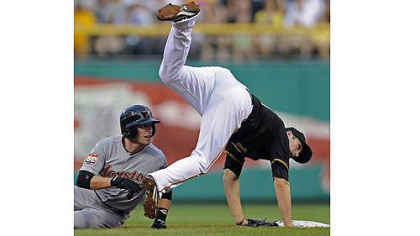 Astros third baseman Scott Moore tags out Pirates Casey McGehee.