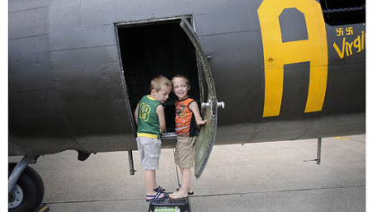 Charles and Eric Tomovcsik of McKeesport check out the Memphis Belle.