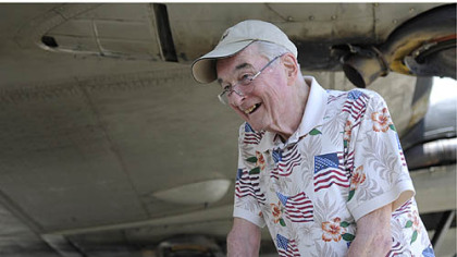 World War II veteran George Cahill, 86, who was a bombardier during the war, stands in front of the B-17.