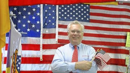 The Flag Factory owner Cliff Ruderer makes sure his customers know that his flags are made in the U.S.A.