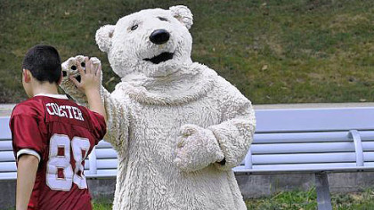 Tessa Flannery, dressed as a polar bear, greets people at Point State Park during the EQT Pittsburgh Three Rivers Regatta on Wednesday.