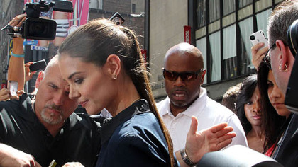Katie Holmes leaves a TV studio on Times Square in New York on Monday.