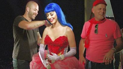 "Stylist Johnny Wujeck, left, prepares Katy Perry before the singer takes the stage in ""Katy Perry: Part of Me,"" opening today."