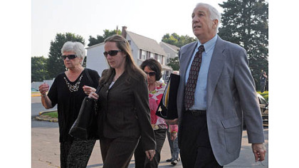 Jerry Sandusky arrives at the Centre County Courthouse with his wife, Dorothy (left) for the closing arguments in his trial today.