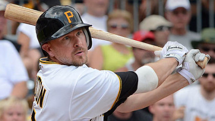 The Pirates&#039; Drew Sutton hits a single.