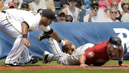 Third baseman Pedro Alvarez tags out Houston&#039;s J.D. Martinez, who got trapped off third, to help quell an Astros rally in the second inning Wednesday at PNC Park.