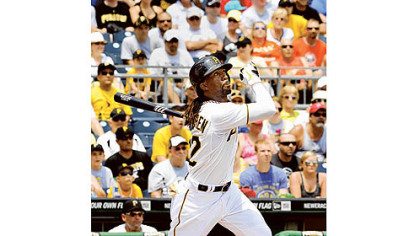 Andrew McCutchen hits a deep fly ball.