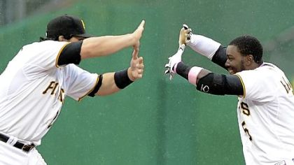 Teammates Rod Barajas and Josh Harrison put their hands together -- the left one on top of the right one with the thumbs extended and touching -- to form a sort of &quot;Z.&quot; For Zoltan.