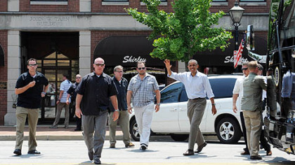 President Obama greets a crowd gathered outside Kretchmar's Bakery on Third Street.