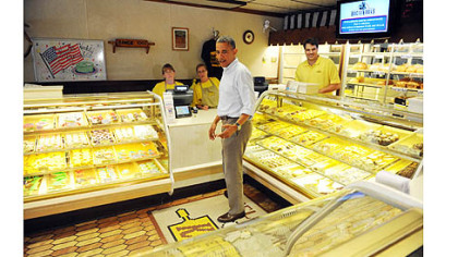 President Obama looks over his options  at Kretchmar's Bakery.