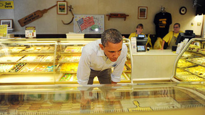 President Barack Obama looks over his options while stopping to buy pie and cookies at Kretchmar's Bakery on Third Street in Beaver today.
