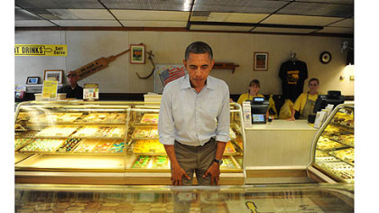 The president examines the bakery cases at Kretchmar's