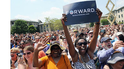 The audience cheer as President Barack Obama speaks at a campaign event at Carnegie Mellon University.
