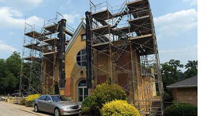 Scaffolding surrounds the bell towers of Saints Mary and Ann Catholic Church in Marianna.