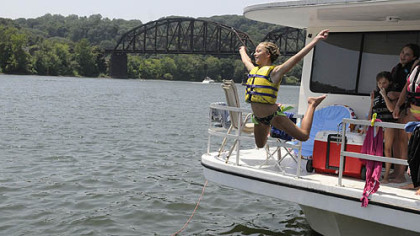 Alexa Bagaley, 12, of McCandless takes a plunge into the Allegheny River at the Aspinwall Marina to cool down.