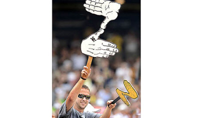 A fan shows support with a Zoltan sign.