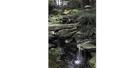 Water splashes over a stone stream built by John Polena in his Mt. Lebanon garden.