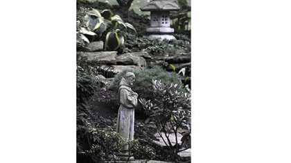 A statue of Saint Francis  graces the backyard are of the Polena's garden.